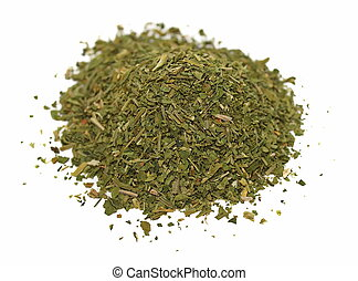 Pile chopped dried parsley leaves isolated on white...