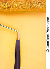 Yellow paint roller handle on a background