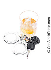 Car key next to a whiskey and a handcuff against a white...