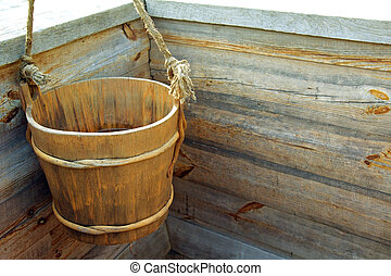 Wooden bucket inside an Old Water Well