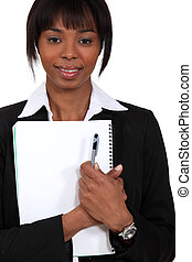 Businesswoman holding notepad and pen
