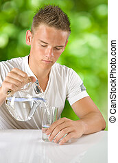 boy filling water in the glass