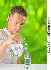 boy filling water