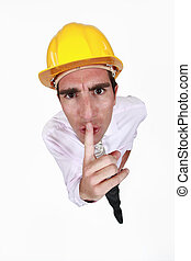 Foreman asking for silence with finger on the mouth