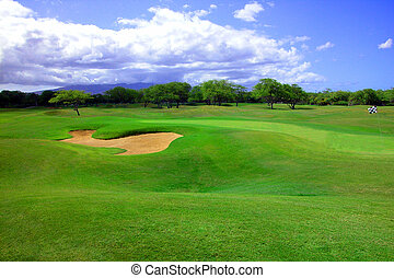 Eva Beach Golf Course - Lush green turf and a sand trap or...