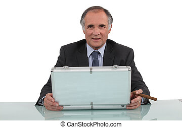 Businessman with a cigar and a briefcase