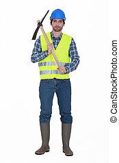 Labourer holding a pickaxe