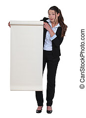 Woman stood with blank roll of paper