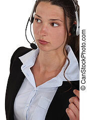 A woman with a headset on.