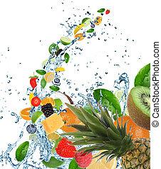Fresh fruits falling in water