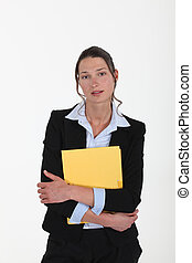 young woman in suit holding a folder