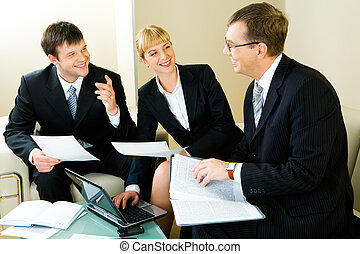 Business meeting - Image of three confident entrepreneurs...