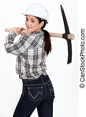 Woman carrying pick-axe