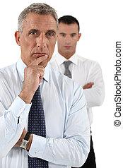 Two intelligent businessmen
