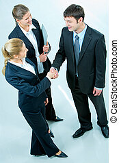 Business agreement - Image of people making a business...