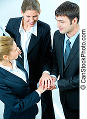 Business union - Image of business people putting their...