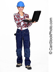 Brunette manual worker holding laptop