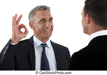 happy businessman making an okay sign