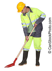 Manual worker with spade
