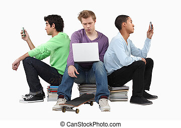 Boys sitting on piles of books