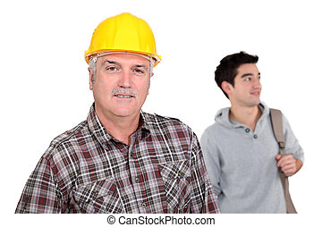 Senior laborer and young man