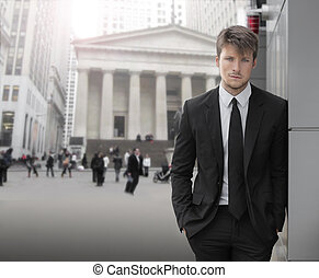 Businessman - Young attractive businessman outdoors with...