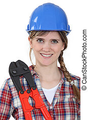 Woman stood holding bolt cutting tool