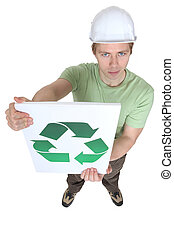 Young man holding sign with symbol of recycling