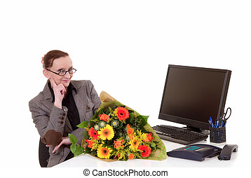 Secretary day, flowers on desk - Attractive middle aged...