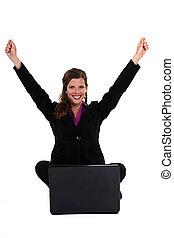 Triumphant businesswoman