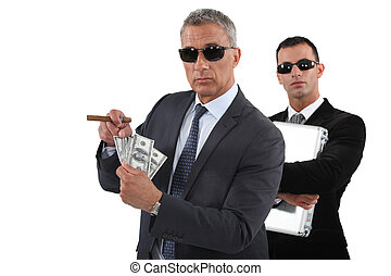 Businessmen with cash