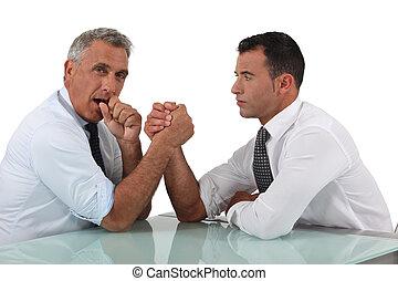 Businessmen doing arm wrestling