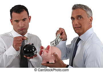 Two businessmen putting money in piggy-banks