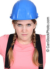 Blond female builder with serious expression on face