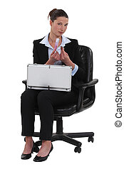 Woman with a briefcase full of money