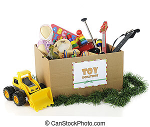 Charity Toys for Christmas - A large corrugated box with a...