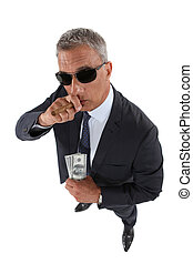 A crook holding stolen money and smoking a cigar