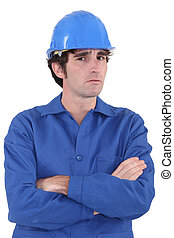 Confused builder with crossed-arms