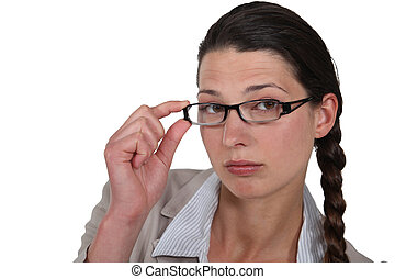 Woman adjusting her glasses