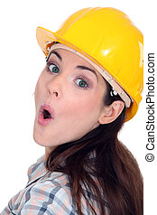 Surprised female builder
