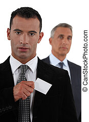 Businessman removing card from pocket