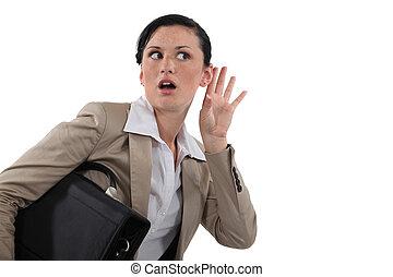 Businesswoman listening in shock