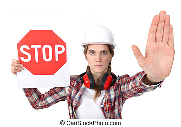 Woman holding stop sign