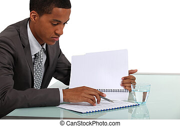 Businessman reviewing a report
