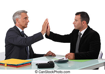 Two business men high-five