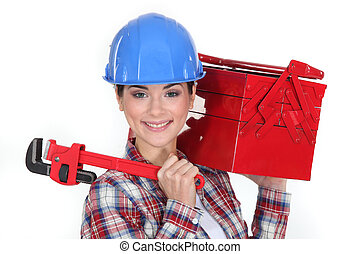 Happy woman carrying tool box