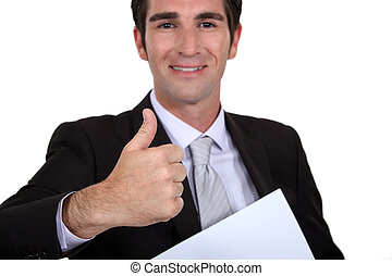A businessman giving the thumb up