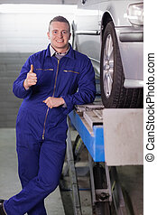 Man standing with his thumb up
