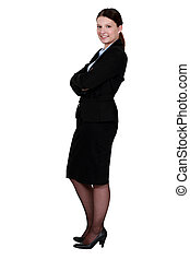 Businesswoman standing with her arms folded