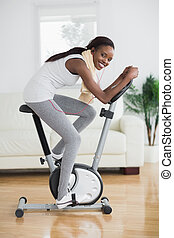 Side view of a concentrated black woman doing sport